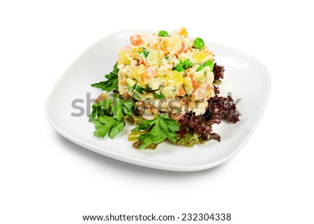 Russian traditional Salad Olivie on a plate. Isolated on white background. - stock photo