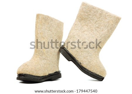 Russian traditional winter felt boot valenki on white background ...
