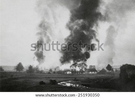 Russian village in flames during the German invasion of the Soviet Union. Summer 1941, retreating Russian armies often destroyed all infrastructure that could be used by the advancing Nazi invaders. - stock photo