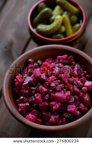 Russian vinaigrette salad with beetroot, pickles and other vegs - stock photo