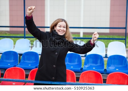 Russian woman fan screaming and gesturing on the national flag seats