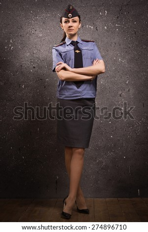 Russian woman police officer in uniform. Low key - stock photo