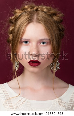 Russsian styled beauty portrait of young ginger girl - stock photo