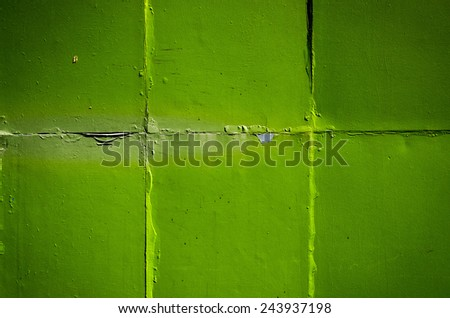 Rust at green metal plate wall - stock photo