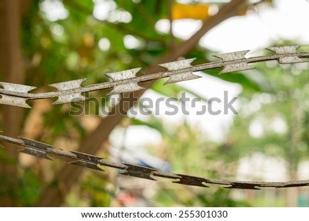 Rust barbed wire fence  - stock photo