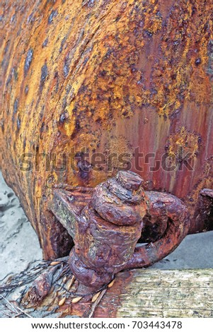 RUST - Extreme Metal Corrosion & Delamination - A beached buoy with extreme corrosion. The attached clevis is showing severe delamination from the constant exposure to sea salts