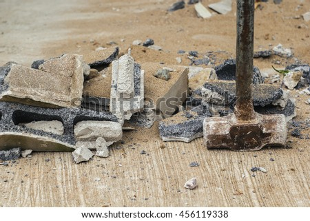 rust hammer on broken brick and cement - stock photo