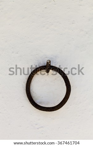 Rust ring on white wall. Christopher Columbus epoch