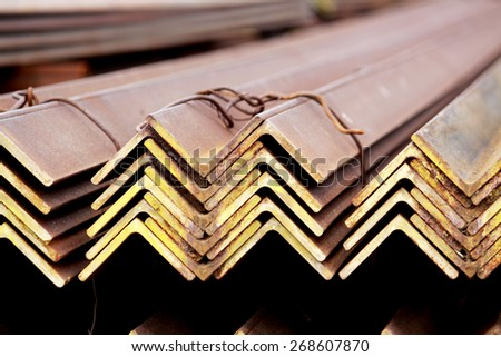 Rust steel angle for raw material in warehouse - stock photo