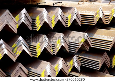 Rust steel angles bunch in warehouse for raw material Steel Transmission line tower - stock photo
