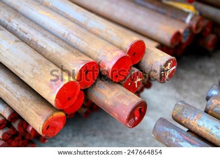 Rust steel bar in warehouse - stock photo