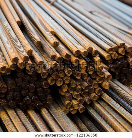 Rust steel rod or bars in warehouse - stock photo
