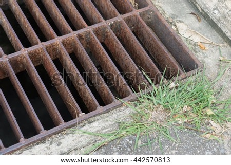 rust steel  sewer cover or sewage drain cover, on public road