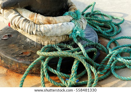 Rusted Anchor Hitch and Rope at Mallory Square at Key West, Florida