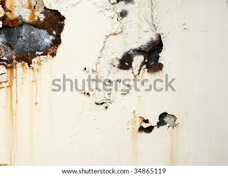 Rusted and corroded surface with chipped white paint background - stock photo