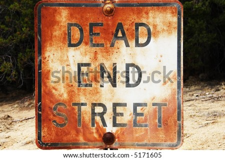 Rusted and weathered Dead End sign. - stock photo