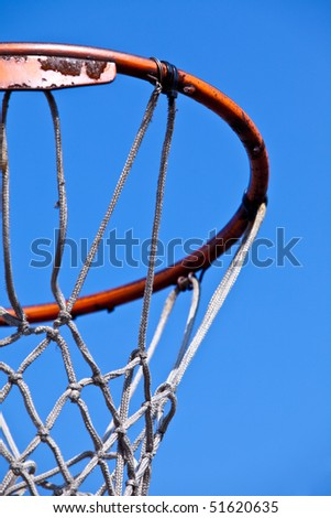 Rusted basketball hoop isolated on blue sky - stock photo