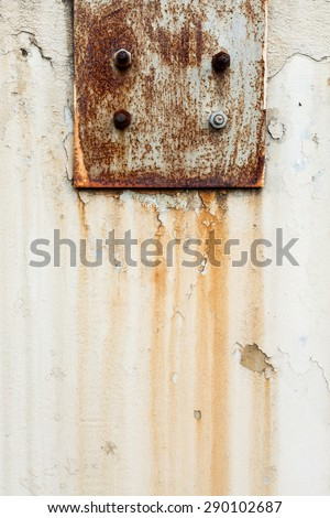 rusted bolts with cement abstract background