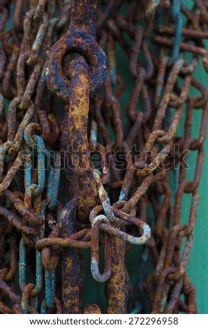 Rusted chain on barn - stock photo