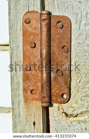 rusted hinge on an old wooden doors - stock photo