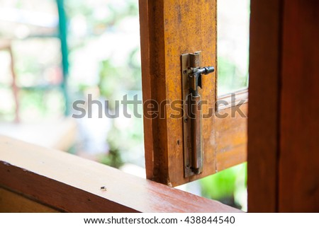 Rusted keyhole on white wooden door. - stock photo