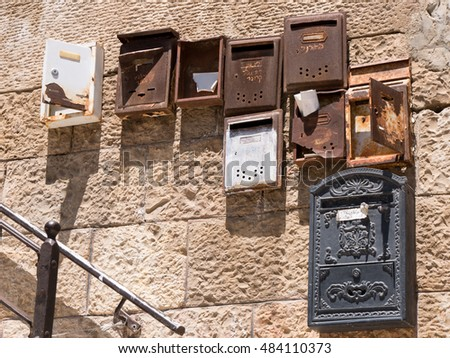 Rusted mailboxes on stone wall in Jerusalem