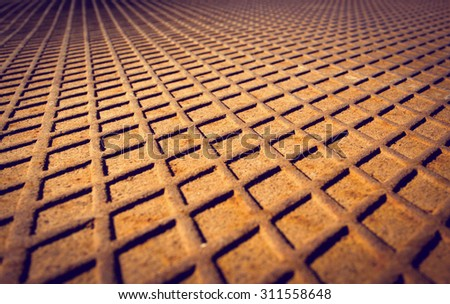 Rusted metal floor with a diamond-shaped pattern. Abstract background - stock photo