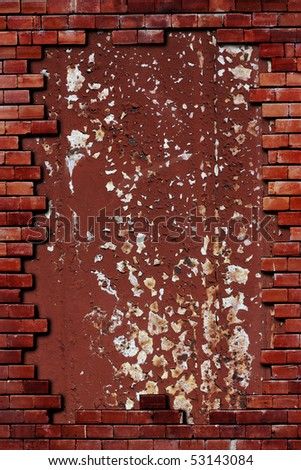 rusted metal in a brick wall - stock photo