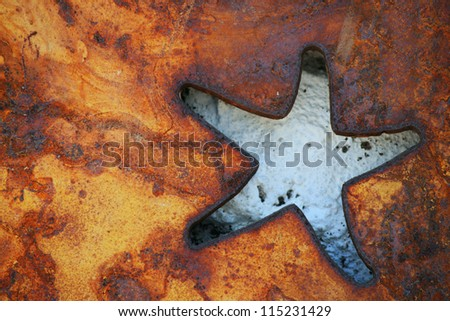 Rusted metal plate background with cut out star