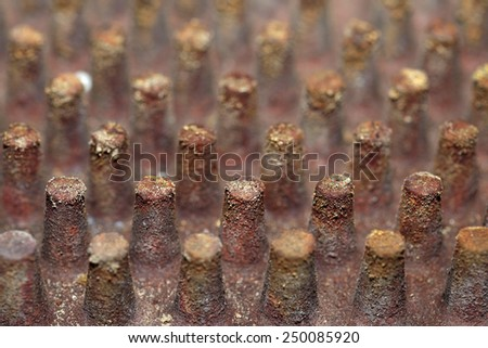 Rusted metal surface with rivet bolts - stock photo