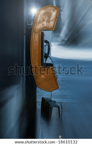 rusted old payphone on a city street background - stock photo