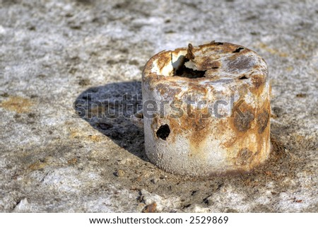 Rusted pot lost on a desert land - stock photo