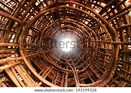 Rusted rings from a rolled up fence - stock photo