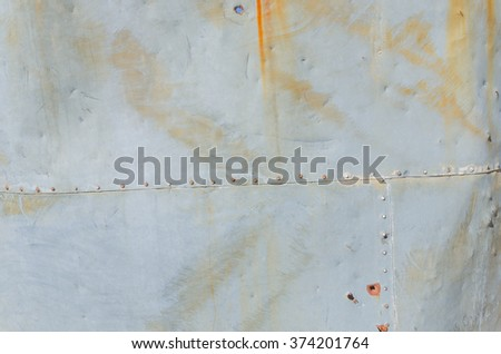 Rusted rivets in sheet metal of water tank at old mill - stock photo