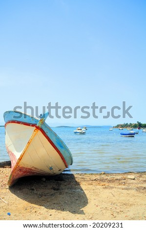 Rusted rowboat beached at Cesme, Turkey - stock photo