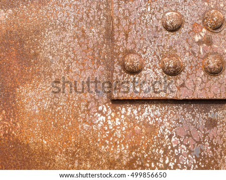 Rusted surface iron panel of a riveted steel construction background texture pattern