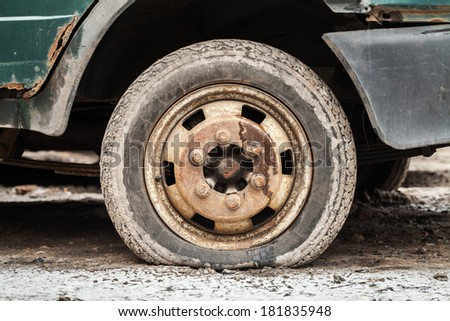 Rusted wheel of old car. Closeup photo - stock photo