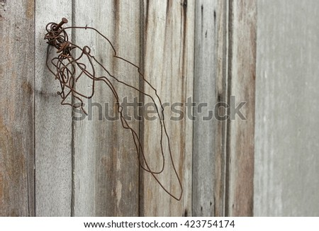 Rusted wire on the Old wooden texture, select focus Rusted wire and soft-focus background. - stock photo