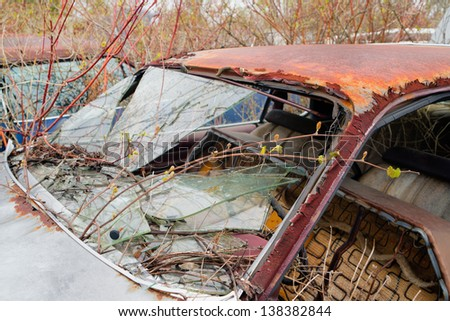 rusted wrecked car