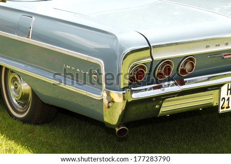 RUSTENBURG, SOUTH AFRICA - FEBRUARY 15:  Blue 1964 Chevrolet Impala Coupe Rear Badge View in Private Collection Philip Classic Cars on February 15, 2014 in Rustenburg South Africa.