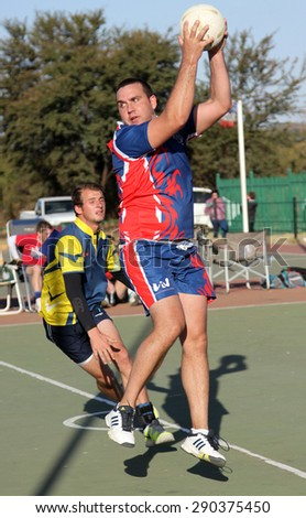 RUSTENBURG, SOUTH AFRICA - June 6:  Korfball League games played at Olympia Park on June 6, 2015 in Rustenburg South Africa.  Mens team:  Man catching ball.