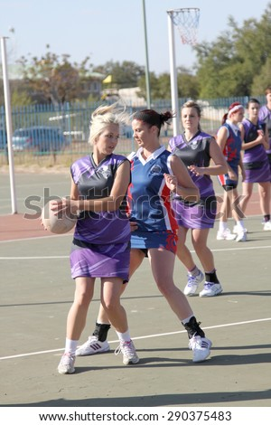 RUSTENBURG, SOUTH AFRICA - June 6:  Korfball League games played at Olympia Park on June 6, 2015 in Rustenburg South Africa.  Ladies team:  Girls competing for ball.