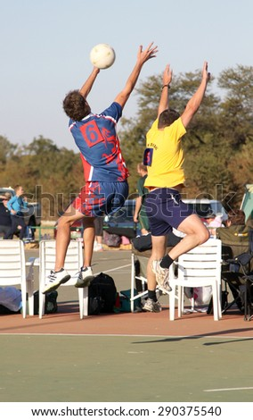 RUSTENBURG, SOUTH AFRICA - June 6:  Korfball League games played at Olympia Park on June 6, 2015 in Rustenburg South Africa.  Mens team:  Man competing for ball in air.