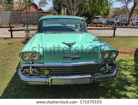 RUSTENBURG, SOUTH AFRICA - SEPTEMBER 9: A green 1958 Chevrolet Biscayne 4 Door on display at Rusoord old aged home celebration on September 17, 2013 in Rustenburg South Africa.