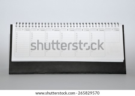 Rustic agenda with metal spiral and marked days, dates and hours - stock photo