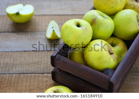 rustic apples in a box, food closeup - stock photo