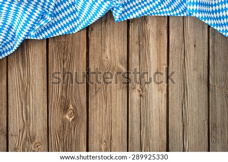 Rustic background for Oktoberfest with bavarian white and blue fabric - stock photo