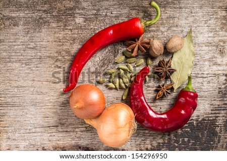 Rustic background of Spices on wooden plank - stock photo