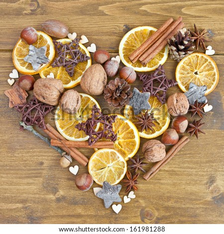 Rustic background with spices and nuts for christmas - stock photo