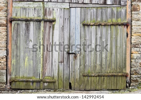 Rustic barn door as a background image - stock photo